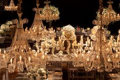 Detail for crystal chandeliers and big arrangements of white flowers