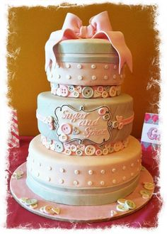 Sugar and Spice Baby Shower Cake-sweet buttons, simple but sweet, grey and pink, the BOW!!! .... love how this turned out!!
