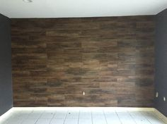 DIY laminate wood wall panel. $84 laminate panels at Low's, $20 cheap mat paint and $14 on adhesive spray VUALA!