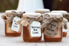 """couple's jam favours were decorated with burlap covers and a """"Spread the Love"""" message"""