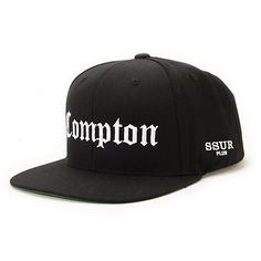 """Take to the streets with the style of the Compton Black snapback hat from SSUR. The Black colorway flaunts a White """"Compton"""" embroidery at the front and """"SSUR Plus"""" at the side so you can represent your hood, while the snapback sizing pieces makes it so t"""