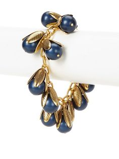 "Lenora Dame Navy Not Your Mother's Pearl Bracelet 80/36 Matte-finished faux pearls with leaf-like caps clustered to create a statement piece Clasp: Lobster Claw Country of origin: United States Authentic product Metal type: 24K Gold-Plated Brass Pearl type: Glass Item Dimensions: length 7.5"", height 1"""