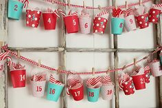 Dixie cups covered in paper to make a candy garland ADVENT calendar!  Too cute!