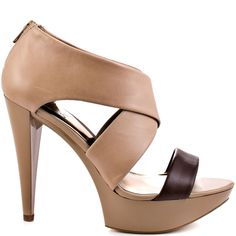 Feel like a top model in the Mixer pump from Carlos by Carlos Santana.  A luscious beige leather covers the upper and is highlighted by a brown single strap vamp.  A 4 3/4 inch heel and 1 inch platform add a flawless elevation.