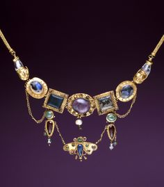 Necklace with butterfly pendant; gold, amethyst, chalcedony, emerald, rock crystal, pearl and coloured glass   Greek, late 2nd - 1st century BC (Hellenistic)