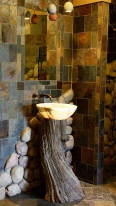 Tree stump sink - interesting idea small bathroom ideas - Not for a tiny house on wheels but fantastic.