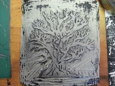 Printing plate for tree. Linocut printmaking