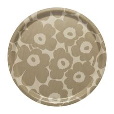 Made of laminated birch plywood, this lightweight tray features the light brown and beige Mini Unikko (poppy) pattern. Unikko (poppy) was born in 1964 after Armi Ratia, Marimekko's founder, had announced that Marimekko would never print a flow Marimekko, Nordic Interior Design, Poppy Pattern, Round Tray, African Textiles, Japanese Patterns, Citronella, Textile Patterns, Floral Patterns