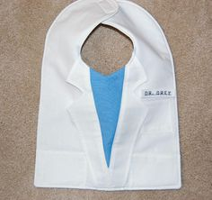 """TV Crafts - Grey's Anatomy Lab Coat Bib -- """"Grey's Anatomy"""" Bib: The baby may not know who Dr. Dreamy is, but if Mommy is a big """"Grey's"""" fan, the education can start now. Also, if you're on top if it, this bib can be personalized. (CarolynsClassics/Etsy)"""