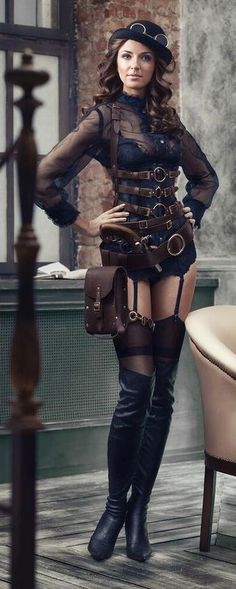 Steampunk Fashion, shes missing the usual skirt but I like the belts and buckles.
