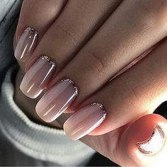 Pink natural ombré nails with a touch of glitter.