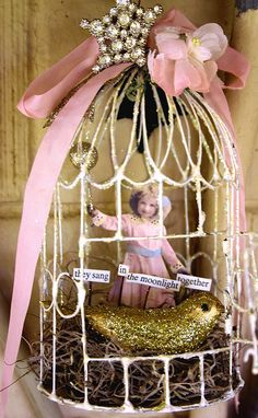 sweet bird and cage made with vintage materials