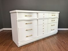 White MCM dresser. A perfect addition to your retro, modern chic, mid century home decor.  Has been painted in General Finishes Snow White milk paint and sealed with HP top coat.  Gorgeous original gold hardware in GF Burnished Pearl.