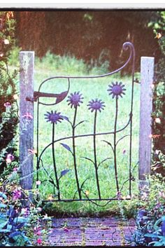 A gate that opens to relaxation. Enrich the looks of your ga.- A gate that opens to relaxation. Enrich the looks of your garden. A gate that opens to relaxation. Enrich the looks of your garden. Metal Garden Gates, Garden Fences, Metal Gates, Iron Gates, Garden Paths, Garden Cottage, My Secret Garden, Dream Garden, Yard Art