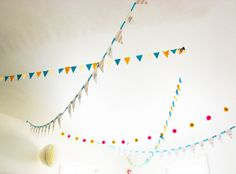 love the combo of the different flag and pom garlands ... so pretty
