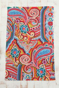 Now thats a pretty funky painted paisley rug. Eclectic, intricate, & bold. From American Outfitters.