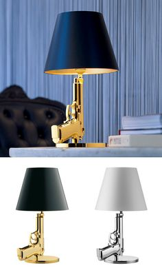 Gun lamp by philippe starck designers have the responsibility to re design negatives into for Philippe starck ak table lamp