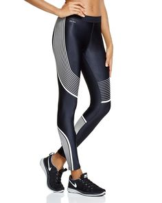Satisfy your need for speed (and sleek workout style) with Nike's graphic printed leggings. | Self: polyester/spandex; lining: recycled polyester | Machine wash | Imported | Elasticized waist with inn