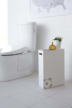 A simple free-standing toilet paper holder with a shelf on top perfect for resting useful and decorative bathroom items. x x We have an extremely attractive wooden toilet brush holder and matching stand here. Bathroom Bin, Bathroom Storage, Empty Wall Spaces, Small Spaces, Wc Decoration, Free Standing Toilet Paper Holder, Diy Rangement, Toilet Paper Storage, Toilet Roll Holder