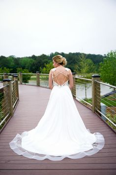 This wedding dress is to die for and so perfect for a destination wedding or beach wedding.