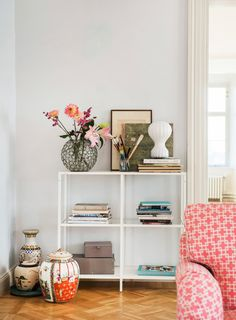 It's all in the details | bookself game of fleek | antique Chinese urns and decorative details | IKEA Stocksund sofa in a Pomela Linera Romo x Bemz cover