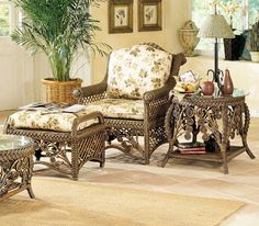 Gazebo Wicker Arm Chair is guaranteed to garner attention with its delightful frame design and southern inspiration. Sprays of whimsical florals featuring wrapped stems adorn the front apron. Heavy rattan fiber plaiting sits just above while bolster rolled arms lead to the mid-height back and arched crest. Double cane panels provide an open surround from the sides to the back.