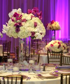 Radiant Orchid Centerpieces... High & Low for a sense of movement in the room -By Asa Flowers