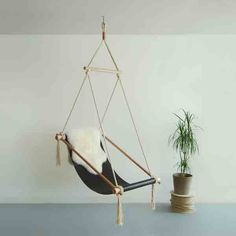 Ovis Hanging Chair  This fashionable leather sling chair would look great in a modern office or library.