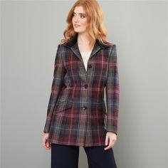 A classic, short tweed coat, featuring a Nehru collar. The fabric is a burgundy, blue & pink patchwork check, designed and woven in our mill in Donegal, Ireland. Style with the matching Carey skirt and blue silk Darcy top.   Fabric – 100% pure new wool Lining – 100% viscose on the body and a Liberty print cotton panel