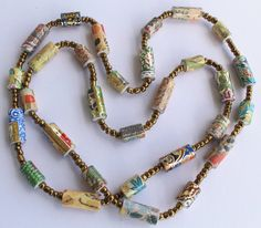 Multifunctional and multicolored paper bead necklace made from paper beads cut from museum cards with an oriental design. Every paper bead has a Paper Bead Jewelry, Fabric Jewelry, Paper Beads, Beaded Jewelry, Beaded Bracelets, Handmade Beads, Handmade Jewelry, Recycled Jewelry, Design Oriental