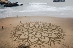 Andres Amador is a contemporary artist that uses the sand in the beach to create his amazing art works.