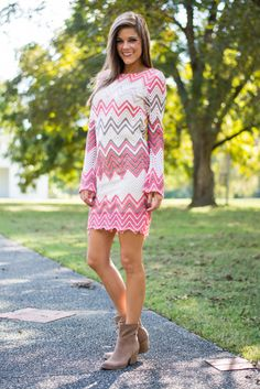"Fall in love and into chevron with this pink cutie! The fit is AHHHmazing and we love the long sleeves! They add such a chic quality to the whole look! This one looks fab with heels or booties, so don't miss out on such amazing versatility. :)   Bra-friendly! Material has minimal amount of stretch. Fully lined.  Miranda is wearing the small.   Sizes fit:  Small- 0-2; Medium- 4-6; Large- 8   Length from shoulder to hem: S- 35""; M- 36""; L- 37""."