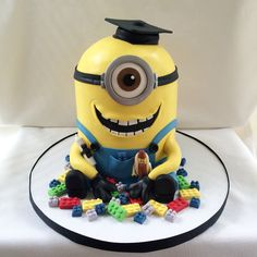 Minion playing with Legos graduation cake