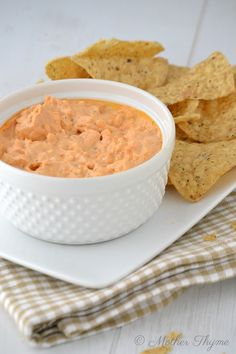 Craving wings while working on your waistline? This is THE solution! Buffalo Cauliflower Dip, serve with baked chips and veggies via Mother Thyme #greekyogurt #lowcarb