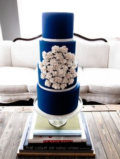 Navy blue wedding cake. I would love this with the flowers cascading from the top.