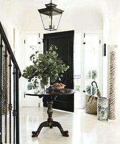 Repurposed Old columns, interior door painted black, lantern