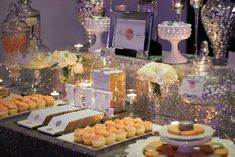 A sequin tablecloth laid the foundation for a sparkling wedding candy buffet with lollies by Candy Bar Sydney.