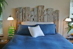 Driftwood headboard for a beach house by Allison Lind Interiors.  Browse Driftwood Decor on Completely Coastal: http://www.completely-coastal.com/search/label/Driftwood%20Decor