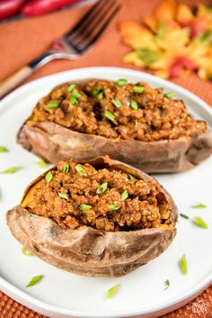 Pumpkin Sloppy Joes - Cozy up to a big pile of this pumpkin-flavored chili with a sweet potato standing in for the bun. #Paleo #GlutenFree
