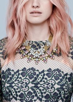 Lace dress, statement necklace and pink hair with waves. Style to copy.