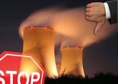 The man is pointing thumb down because he saying nuclear reactor are harmful to environment.