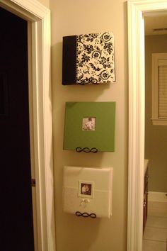 Photo albums displayed on plate hangers.