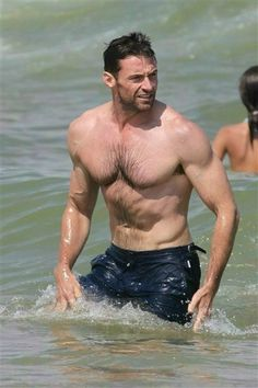 Hugh Jackman shows off his incredible muscles in the surf! Drool...