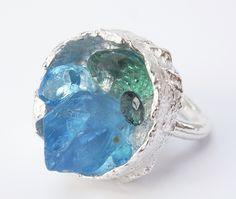 boxcast ring in sterling silver with gemstones in blue hues. Kelvin J. Birk 2020 Green Tourmaline, Contemporary Jewellery, Jewelry Art, Topaz, Gemstone Rings, Silver Rings, Jewels, Gemstones, Crystals