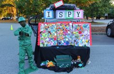 Trunk or Treat - I Spy Game... Just glue LOTS of little toy junk on the boards (puzzle pieces, kids meal toys, stickers, even broken ones!) Take a picture of each one as you glue it on. Then show 2 competitors a picture (we had them on the iPad). One who finds it first wins a prize! The kids LOVED it! Also, that is my son as a toy Army man.