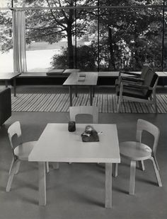 The Finnish Pavilion living room at the XI Triennale di Milano in 1957: Children's furniture by Alvar Aalto (originally designed in 1930s) and Triennale lounge chairs by Carl-Gustaf Hiort Af Ornäs...