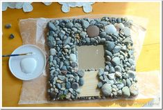 This craft idea is perfect for all those smooth beach rocks you've collected over the years! Showing the step by step process, this diy tutorial will help you create a beautiful mosaic beach rock mirror. Stained Glass Birds, Stained Glass Panels, Mirror Mosaic, Mosaic Wall, Snowman Ornaments, Christmas Tree Ornaments, Mosaic Rocks, Rock Mosaic, Mother Daughter Crafts