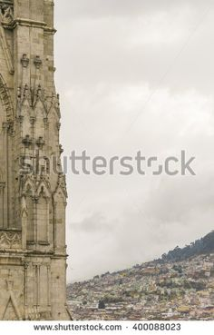 Low angle detail view of neo gothic style San Juan Basilica and cityscape at background at historic center of Quito, Ecuador