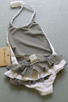 little girl's swimsuit - we love grey and white! The perfect color combination for a swimsuit, or any outfit for that matter.