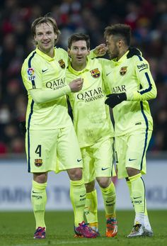 Lionel Messi (C) of FC Barcelona celebrates after scoring during the La Liga match between Athletic Club and FC Barcelona at San Mames Stadium on February 8, 2015 in Bilbao, Spain.